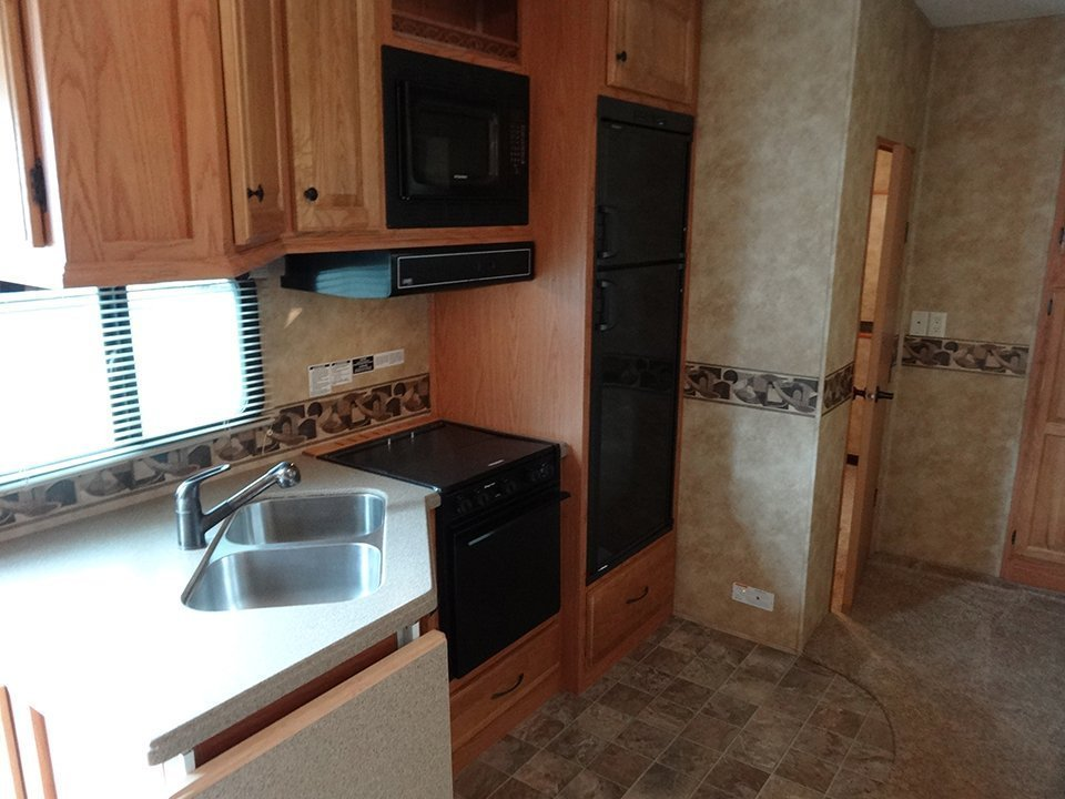 2009 Big Country 5th Wheel Interior View Kitchen Seating Area Facing Rear