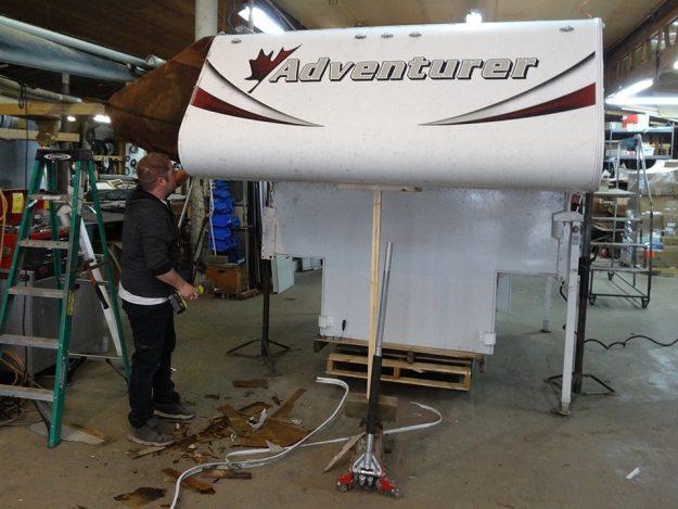 Kenkraft RV Tech repairing slide-in camper unit